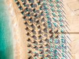 Sunchairs and umbrellas on the beach at Porto Vathy Beach, Thasos Island, Greece - 248813103