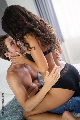 Leinwanddruck Bild Beautiful passionate couple is having sex in bedroom