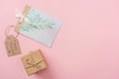 gift box, mothers day greeting card and wooden label with happy mothers day greeting text on pink background