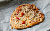 Homemade pizza with tomatoes - 248843192