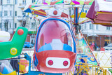 attraction, swing in the form of cars in an amusement park - 248848767