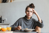 Beautiful young woman having healthy breakfast