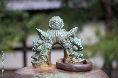 dragon ornament on top of bell - japan © Stephen