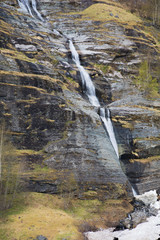 Severe northern nature, waterfall in the mountains of Norway
