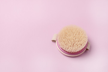 Beauty and Skin Care Spa Products Bath Accessories Body Brush Pink Background Top View