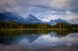 Mountains reflecting in the calm waters of Spillway Lake in Peter Lougheed Provincial Park, Alberta, Canada