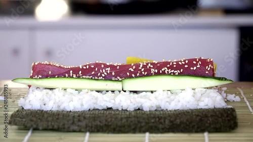 Chef hands preparing fresh maki sushi