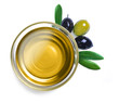 Glass bowl with olive oil with leaves on white