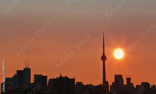 Toronto's skyline lit by sun raising behind the buildings