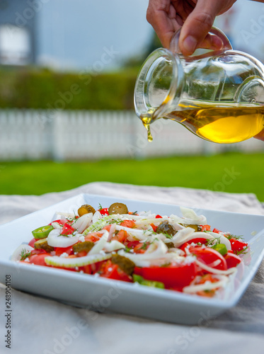 Homemade, healthy salad with tomatoes, onion and olive oil - 248904108