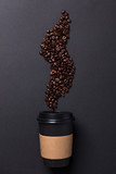Take away black coffee cup with roasted coffee beans