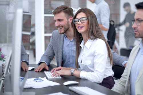 group of business people sitting at the office table
