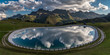 Quadro Mountain landscape with a water mirror. Dolomites, South Tyrol, Italy.
