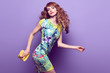 Leinwandbild Motiv Fashion. Girl jumping fooling around in studio. Young beautiful happy woman having fun smiling dance in Fashion Stylish outfit, makeup. Cheerful fashionable model on purple