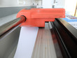 Paper cutter cut the scientific poster printed for scientific conference