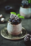 Chia seed pudding with honey, frozen blueberries and blackberries. Delicious and healthy organic dessert.