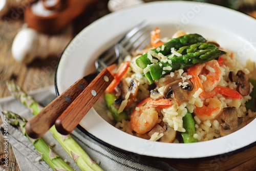 Italian risotto with shrimps, mushrooms, asparagus and parmesan. Healthy food. - 248966711