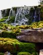 waterfall splashing on mossy rocks below - 248980924