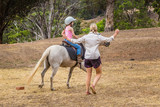 Young child learning to ride in the Upper Hunter Valley, NSW, Australia. - 249006598