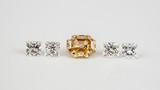 Natural color diamond with princess cut diamonds