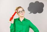 Woman holding big oversized pencil thinking - 249017349