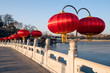 Lots of red lanterns hang on the fence of the bridge, Beihai park of Beijing