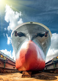 bulk head of the commercial ship sitting on floating dry dock yard, recondition, repairing, painting overhaul in dock yard terminal - 249047584