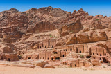 View of large cliff side tomb carved from the beautiful richly colored sandstone in the ancient city of Petra, Jordan. - 249057946