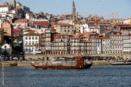 Douro River with river cruise boat and old town of Porto