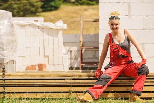 Woman taking break on construction site - 249086508