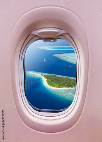 Airplane window view of Maldives islands