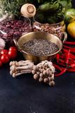 Still life vegan food set on dark background. Concept healthy eating. Beans, lentils, chili, nut, cucumber, spinach, mushrooms shimidzhi, cherry tomato. - 249096534