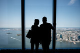 Tourists looking out of the window from the World Trade Center One Building in New York