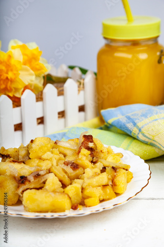 Fried potatoes on the dinner table. - 249116364