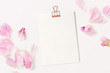 Leinwandbild Motiv feminine mockup with blank card, rose gold paper clip and pink peony petals - perfect for inspirational quotes, announcements or as a greeting card
