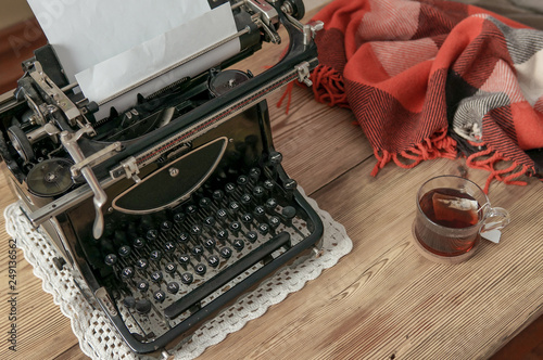Workplace old school writer with tea and typewriter