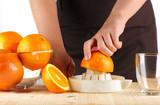 girl preparing fresh citrus juice