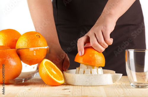 girl preparing fresh citrus juice © Artem