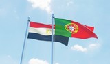 Portugal and Egypt, two flags waving against blue sky. 3d image