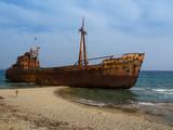 Rusty corroding Dimitrios shipwreck on a sandy beach near Gythio, Greece