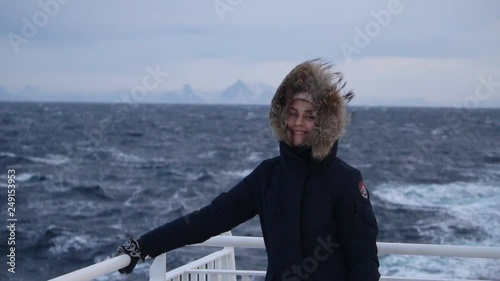 girl sailing on a ship in the winter sea