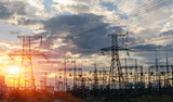 distribution electric substation with power lines and transformers, at sunset - 249154367