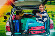 Summer vacation, young girl in the car is ready for travel for family vacation.