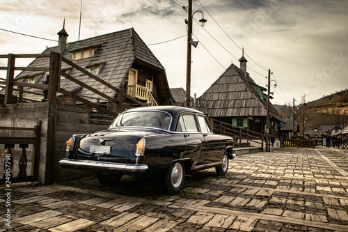 Oldtimer car in traditional retro village