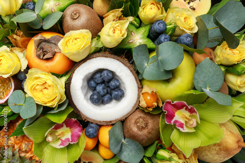 Wooden box with lots of exotic fruits and flowers as a gift. Close-up © ovbelov1972