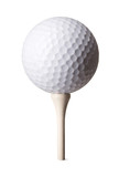 White golf ball on tee on white background