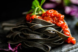 Italian black pasta with red tomato sauce - 249170133