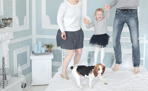 happy family playing in bedroom free day.
