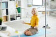 Leinwanddruck Bild - High angle portrait of contemporary mature businesswoman meditating in office, copy space