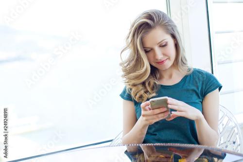 Leinwanddruck Bild Woman with phone